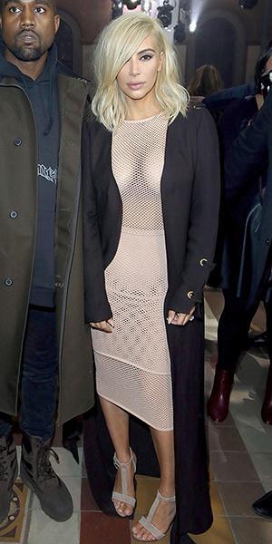 Newly blonde Kim Kardashian wearing Lanvin Studded Beige Suede T-Strap Sandals to fashion show in Paris