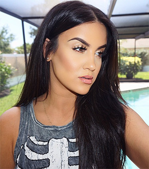 Nicole Guerriero wearing a Nasty Gal Inside Out Skeleton Tank Top