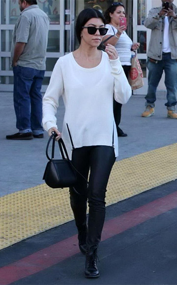 b9d5ae718e Kourtney Kardashian spotted in Feel The Piece Soma Cashmere Sweater
