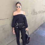 Olivia Culpo wears a Tibi Off-The-Shoulder Long-Sleeved Top, Tod's weave bag and Unravel lace up jeans.