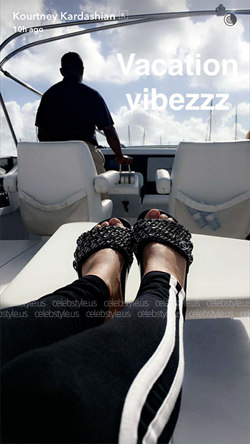 Kourtney Kardashian chills on a yacht in Miami during July 4th holiday weekend in a Chanel Iconic Silver Chain Mule Sandals.