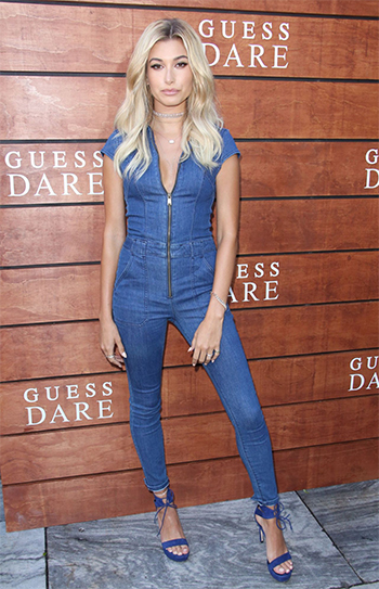 Hailey Baldwin: Guess Jessie Denim Utility Jumpsuit and Stuart Weitzman Tynela Ankle Strap Sandals