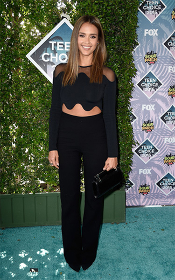 Jessica Alba in David Koma Shoulder Net Crop Top and pants and a M2MALLETIER clutch at the 2016 Teen Choice Awards on July 31, 2016.