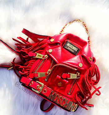 InstaStyle: Moschino Red Biker Jacket Crossbody Bag as seen on Kinsey Schofield Instagram.