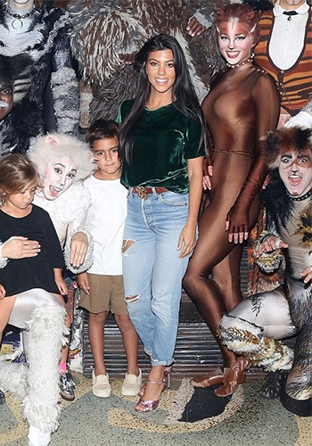 Kourtney Kardashian 'Cats' on Broadway: Drifter Paix Baby Tee and Gucci Knotted Metallic Sandals