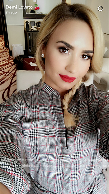Demi Lovato in Isabel Marant Tricolor Khol Dress on Snapchat before Koleston Astonishing Blonde Hair Dye photo call on October 16, 2016