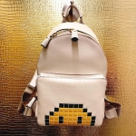 Kinsey Schofield, Anya Hindmarch Mini Pixel Smiley Leather Backpack (Instagram December 11, 2016)