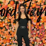 Victoria Justice wears a Miss Selfridge Bow Sleeve Jumpsuit to the Lord & Taylor Stamford Grand Re-opening Celebration — December 1, 2016