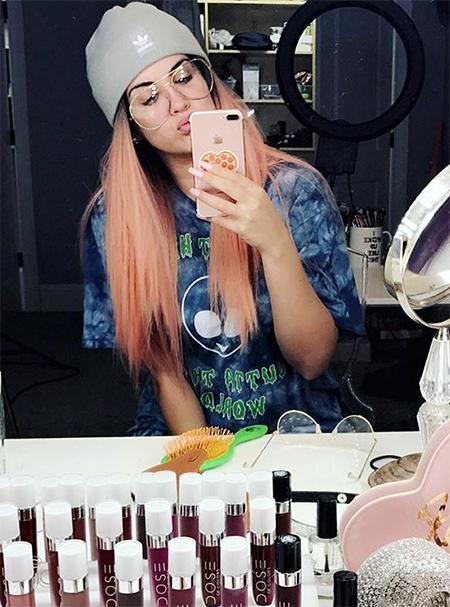 Nicole Guerriero wearing Adidas beanie, Forever 21 tee and Kimoji case (Instagram December 30, 2016)
