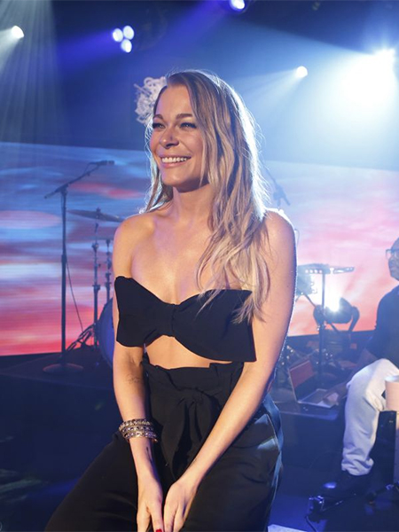 LeAnn Rimes in H&M bow bandeau bralette top and ALC bow tie high waisted trousers while performing on Jimmy Kimmel Live March 7, 2017