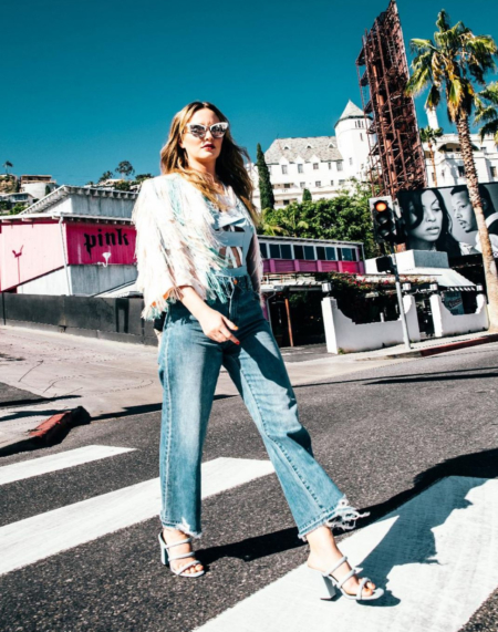 Leighton Meester wears Le Specs Ashanti sunglasses, a Elisabetta Franchi jacket, Asilio top, DL 1961 Premium Denim Hepburn high-rise wide-leg jeans with shredded hem and Sol Sana Deon mules in Ice Blue for the May 2017 issue of Bello magazine.