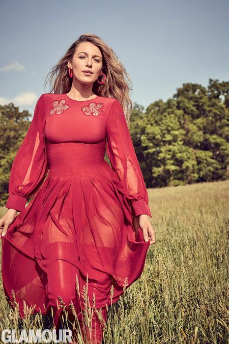 Glamour Magazine's September 2017 cover star Blake Lively strikes a pose wearing a red Fendi Embroidered Crepe & Silk Georgette Dress and matching Fendi Rockoko Rib-knit And Leather Over The Knee Boots. Her red hoop earrings are by Jennifer Fisher.