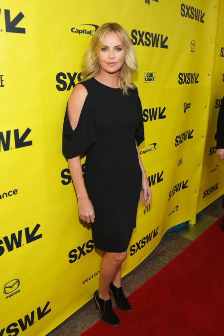 "Charlize Theron wore a 2016 Spring Givenchy Cut Out Drape Sleeve Sheath Dress to the ""Atomic Blonde"" premiere 2017 SXSW Conference and Festivals on March 12, 2017 in Austin, Texas."
