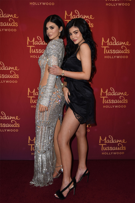 Kylie Jenner poses alongside her new wax figure at Madame Tussauds Hollywood's unveiling on July 18, 2017 in Los Angeles, CA. She's wearing the Olgana Amazone silk satin sandals from the new season.