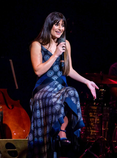 Lea Michele, who has been promoting her latest album 'Places', wears a Diane von Furstenberg Scarf Hem Silk Midi Dress as she talks to the crowd during a live show at the Moore Theatre in Seattle, Washington on May 8, 2017.