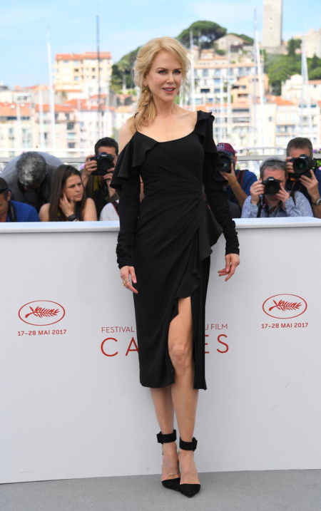Nicole Kidman poses in a Versace dress and Christian Louboutin Harler Suede Pointed-Toe Pumps during a photocall for the tv series 'Top Of The Lake: China Girl' at the Cannes Film Festival in Cannes, France, on May 23, 2017.