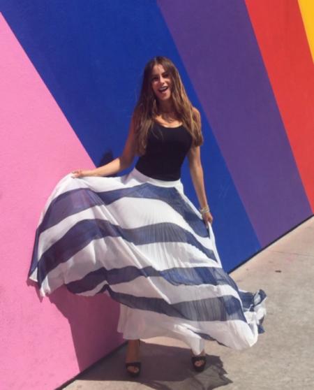 Sofia Vergara in Alice + Olivia Shannon Asymmetric Pleated Printed Georgette Maxi Skirt on Instagram, June 9 2017.