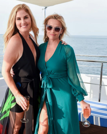 Reese Witherspoon wears a Haney Coco Dress in Aquamarine at the HANEY x FWRD Hamptons Yacht Party on July 21, 2017.