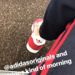 LeAnn Rimes keeps it sporty and casual on her Instagram story (June 22) in a pair of Adidas stripe jogger pants and Adidas Originals Red Suede Gazelle Unisex Sneakers