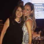 Nicole Lapin poses with PR wizard Laurie Goldberg on Instagram (July 20), wearing a Jonathan Simkhai Two-Tone Lace Ruffle Hem Minidress.