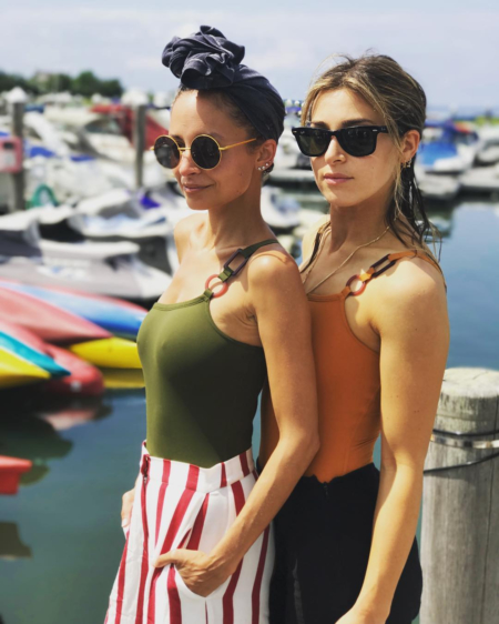 Nicole Richie poses in a Eres Diagramme One-Shoulder One-Piece Swimsuit in Dark Green and a pair of House of Harlow 1960 x Revolve Mona Pants in Carmine for an Instagram pic posted on July 17, 2017.