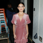 "Danielle Campbell attends the Flaunt and Reebok ""The Eternal Issue"" celebration, wearing a shimmering pink velvet wrap dress by Misa Los Angeles, featuring a braided belt with short flared sleeves, on September 8, 2017 in NYC."