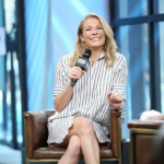 LeAnn Rimes wears a striped shirt dress and Alaïa Suede Platform Ankle Boots as she discusses her role in the film 'Logan Lucky' at Build Studio at AOL on August 17, 2017 in NYC.
