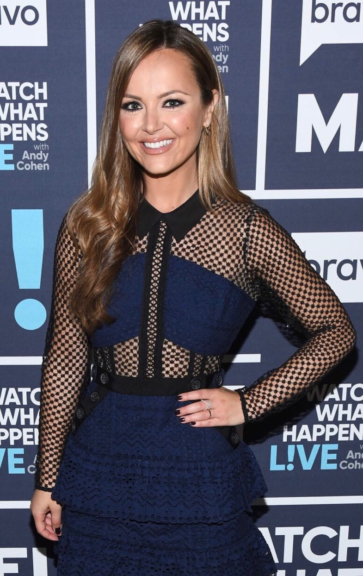 """Nicole Lapin on Bravo's """"Watch What Happens Live"""" wearing a Self-Portrait Hazel Lace Mesh Mini Dress with a pair of point-toe Christian Louboutin pumps. She accessorized with gold Pamela Love Five Spike Stud Earrings, a the EF Collection 14k White Gold Pave Gold Diamond X Ring and the sassy Nora Kogan WTF Signet Ring."""